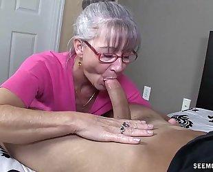 Horny granny sucks a youthful wang