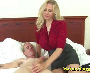 Busty cougar jerking weenie and acquires creamed on