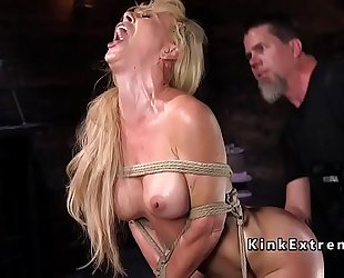 Hogtied golden-haired hanged in rope slavery