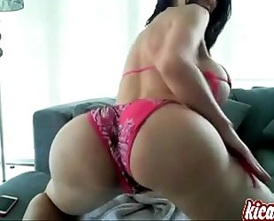 Brunette with biggest love melons undresses & fingers herself