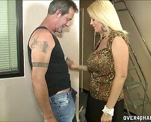 Hot breasty milf jerks off a older dude