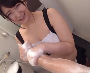 Shy Japanese girl pleasuring her lover in the bathroom