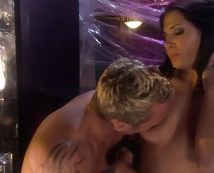 Raven-haired bitch in high boots pleasuring her horny lover