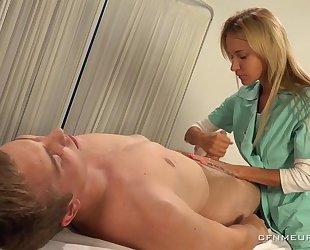 Luscious blonde doctor fucks lucky guy with strapon dildo